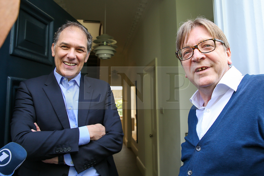 © Licensed to London News Pictures. 10/05/2019. London, UK. Guy Verhofstadt, the EU Parliament's representative on Brexit and the Leader of the Alliance of Liberals and Democrats for Europe speaking with Marc Vlessing a resident in Camden, north London during canvassing for the Liberal Democrats European Union election campaign. Britain must hold European Parliament elections on 23rd May 2019 or leave the European Union with no deal on 1st June 2019 after Brexit was delayed until 31st October 2019, as Prime Minister, Theresa May failed to get her Brexit deal approved by Parliament. Photo credit: Dinendra Haria/LNP