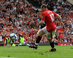Wayne Rooney scores the first goal during the Barclays Premier League match between Manchester United and Birmingham City at Old Trafford on August 16, 2009 in Manchester, England.