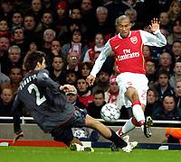 Photo: Ed Godden.<br /> Arsenal v CSKA Moscow. UEFA Champions League, Group G. 01/11/2006. Arsenal's Gael Clichy (R) is tackled by Deividas Semberas.
