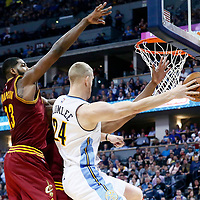 22 March 2017: Denver Nuggets center Mason Plumlee (24) passes the ball around Cleveland Cavaliers center Tristan Thompson (13) during the Denver Nuggets 126-113 victory over the Cleveland Cavaliers, at the Pepsi Center, Denver, Colorado, USA.