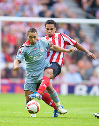 SUNDERLAND, ENGLAND - Saturday, August 16, 2008: Liverpool's Nabil El-Zhar and Sunderland's Kieran Richardson during the opening Premiership match of the season at the Stadium of Light. (Photo by David Rawcliffe/Propaganda)