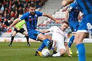 Eoghan O'Connell of Rochdale is tackled by Sam Finley of Accrington during the EFL Sky Bet League 1 match between Rochdale and Accrington Stanley at the Crown Oil Arena, Rochdale, England on 12 October 2019.