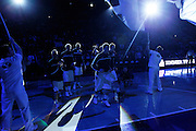 The BYU Cougars, led by guard Jimmer Fredette, second  from right, walks on to the court as the starters are announced before an NCAA college basketball game against Utah in Provo, Utah, Saturday, Feb. 12, 2011. (AP Photo/Colin E Braley)