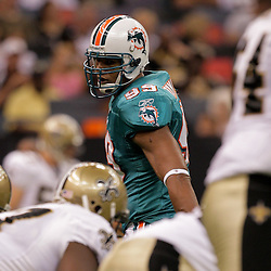 2009 September 03: Miami Dolphins linebacker Jason Taylor (99) lines up for a play during a preseason game between the Miami Dolphins and the New Orleans Saints at the Louisiana Superdome in New Orleans, Louisiana.