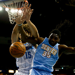 Mar 25, 2013; New Orleans, LA, USA; Denver Nuggets small forward Kenneth Faried (35) and New Orleans Hornets center Robin Lopez (15) battle for a rebound during the first quarter of a game at the New Orleans Arena. Mandatory Credit: Derick E. Hingle-USA TODAY Sports