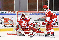 2020-02-12 | Ljungby, Sweden: Troja-Ljungby (36) Wictor Ragnewall see the puck shot from Huddinge IK (9) Victor Andersson in net behind him during the game between IF Troja / Ljungby and Huddinge IK at Ljungby Arena ( Photo by: Fredrik Sten | Swe Press Photo )<br /> <br /> Keywords: Ljungby, Icehockey, HockeyEttan, Ljungby Arena, IF Troja / Ljungby, Huddinge IK, fsth200212, ATG HockeyEttan, Allettan