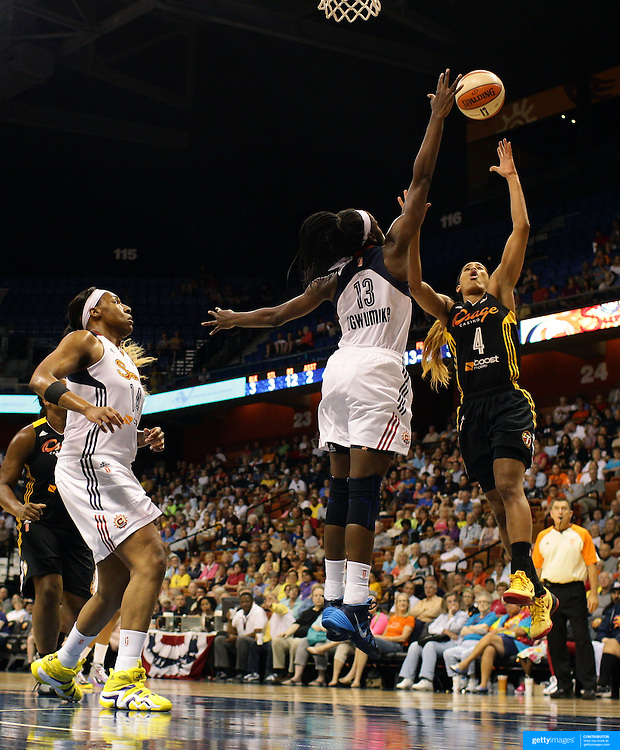 Skylar Diggins, (right), Tulsa Shock, shoots over Chiney Ogwumike, Connecticut Sun, during the Connecticut Sun Vs Tulsa Shock WNBA regular season game at Mohegan Sun Arena, Uncasville, Connecticut, USA. 3rd July 2014. Photo Tim Clayton