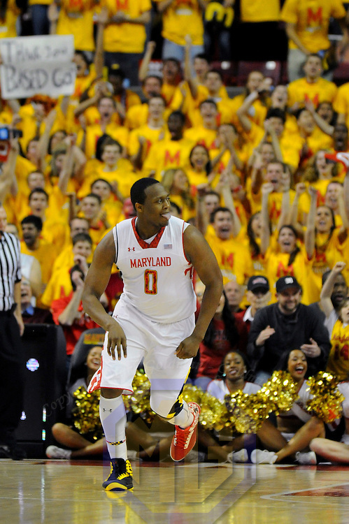 16 February 2013:   Maryland Terrapins forward Charles Mitchell (0) reacts after scoring a basket in action against the Duke Blue Devils at the Comcast Center in College Park, MD. where the Maryland Terrapins upset the second ranked Duke Blue Devils, 83-81.