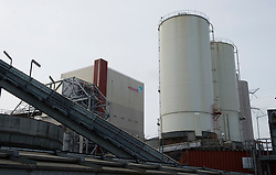 The bio-mass storage facility at the Essent Energie power station, in Geertruidenberg, Netherlands, on Monday March 22, 2010. Bio-mass or compressed wood, is added to the coal for a cleaner burn, in an effort to make the production of electricity more environmentally friendly. Essent Energie is owned by RWE AG. (Photo © Jock Fistick)