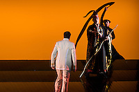 """LONDON, UK, 14 May, 2016. David Butt Philip (in white, as Pinkerton) rehearses with members of the cast for the revival of director Anthony Minghella's production of Puccini's opera """"Madam Butterfly"""" at the London Coliseum for the English National Opera. The production opens on 16 May. Photo credit: Scott Rylander."""