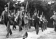 With invasion by Germany threatening, the Local Defence Volunteers was created in Britain in May 1940. Known as the Home Guard, they were men from 17 to 65.  Home Guard members training.