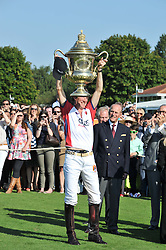 HRH the DUKE OF EDINBURGH presents the Coronation Cup to LUKE TOMLINSON at the Audi International Polo Day held at Guards Polo Club, Smith's Lawn, Windsor on 22nd July 2012.