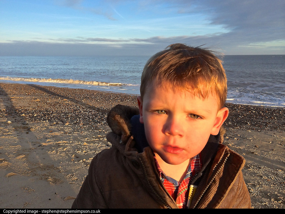 © Licensed to London News Pictures. 01/12/2013. Southwold, UK. Ethan at Southwold - First holiday. Photo credit : Stephen Simpson/LNP