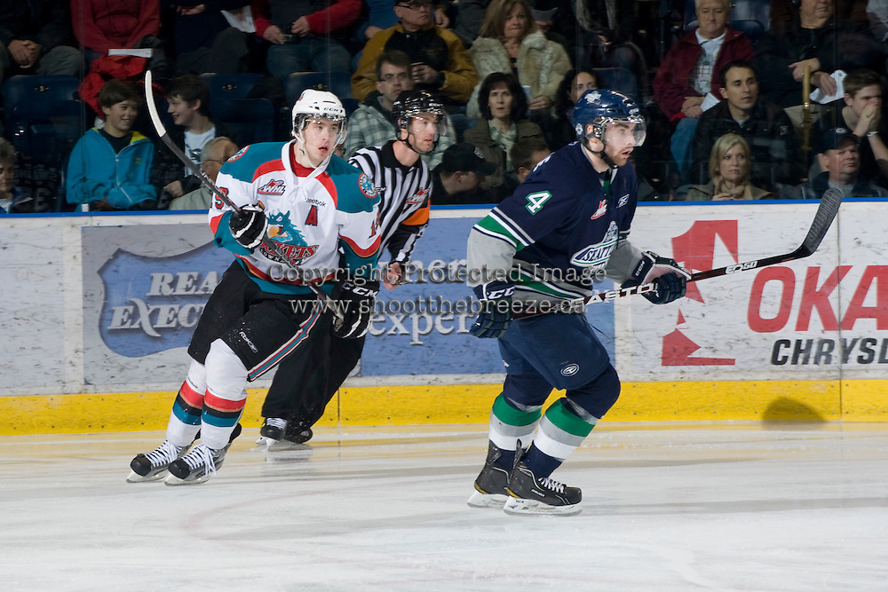 KELOWNA, CANADA, FEBRUARY 8: Brett Bulmer #19 of the Kelowna Rockets and Brad Deagle #4 of the Seattle Thunderbirds skate on the ice as the Seattle Thunderbirds visit the Kelowna Rockets on February 8, 2012 at Prospera Place in Kelowna, British Columbia, Canada (Photo by Marissa Baecker/www.shootthebreeze.ca) *** Local Caption ***