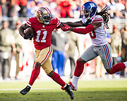 San Francisco 49ers wide receiver Marquise Goodwin (11) fights off the New York Giants defense for a touchdown at Levi's Stadium in Santa Clara, Calif., on November 12, 2017. (Stan Olszewski/Special to S.F. Examiner)