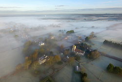 © Licensed to London News Pictures. 30/01/2018. Ripe, UK.  The village of Ripe appears out of morning mist in rural East Sussex after a cold night.  Photo credit: Peter Cripps/LNP