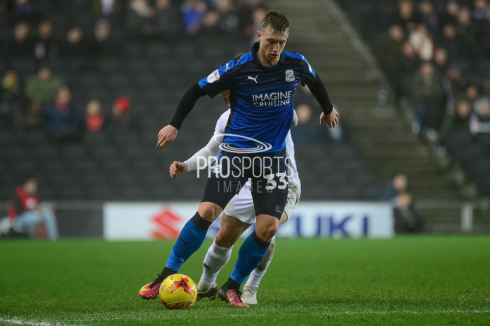 Swindon Town striker Luke Norris (33) shields the ball during the EFL Sky Bet League 1 match between Milton Keynes Dons and Swindon Town at stadium:mk, Milton Keynes, England on 30 December 2016. Photo by Dennis Goodwin.
