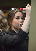 Kayleigh Marks, the designated CEO of her group, draws out her group's product during an activity at Startup Weekend Athens at the Ohio University Innovation Center on March 18, 2016.