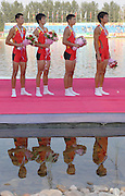 Beijing, CHINA. A Finals, Reflections, Chinas Men's Quad, CHN JM4X, gold medallist left to right, Pengan TENG, Shuo WANG, Hang LI and Haijiao SHAN,line up for the national anthem, after receiving their Gold medals, for winning the final at  the  2007. FISA Junior World Rowing Championships,  Shunyi Water Sports Complex. 11/08/2007 [Photo, Peter Spurrier/Intersport-images]..... , Rowing Course, Shun Yi Water Complex, Beijing, CHINA,