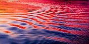 Vivid sunset on boat wake.