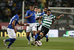 September 1, 2018 - Lisbon, Portugal - Bruno Fernandes of Sporting (R) vies for the ball with Crivellaro of Feirense (L)  during Primeira Liga 2018/19 match between Sporting CP vs CD Feirense, in Lisbon, on September 1, 2018. (Credit Image: © Carlos Palma/NurPhoto/ZUMA Press)