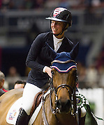 AMY MILLAR (CAN) rides Heros during the prize giving ceremony of the Greenhawk Canadian Championship at The Royal Horse Show in Toronto, Ontario. MILLAR finished 5th in the event.