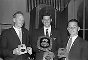 03/07/1963<br /> 07/03/1963<br /> 03 July 1963<br /> David Brown Tractor and Implements Maintenance Awards presented by Minister of Industry and Commerce Jack Lynch TD at the Shelbourne Hotel, Dublin. Picture shows the main award winner and the two runners up with their trophies.