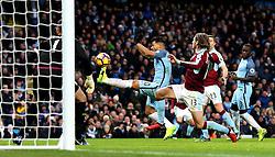 Sergio Aguero of Manchester City shoots under pressure from Jeff Hendrick of Burnley - Mandatory by-line: Matt McNulty/JMP - 02/01/2017 - FOOTBALL - Etihad Stadium - Manchester, England - Manchester City v Burnley - Premier League