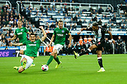 Lewis Dunk (#5) of Brighton & Hove Albion slides to block the shot from Joelinton (#9) of Newcastle United during the Premier League match between Newcastle United and Brighton and Hove Albion at St. James's Park, Newcastle, England on 21 September 2019.