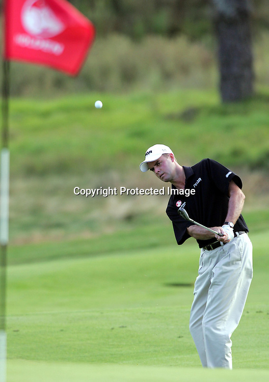 David Smail (NZ) chips towards the hole during Round 2 at the Holden New Zealand Golf Open at Gulf Harbour, Whangaparaoa, New Zealand on Friday 11th February, 2005.<br />