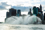 Brooklyn, NY - 9 September 2017. Fireboat Three Forty Three from the Fire Department of New York puts on a show in the East River for spectators in Brooklyn Bridge Park.The boat, named after the number of firefighters lost during the attacks on September 11, 2001, is the largest of its type ever built, and can pump 50,000 gallons of water a minute.