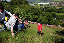 UK ENGLAND COOPERS HILL 31MAY04 - Contestants throw themselves off the top of a steep 200-metre slope in pursuit of a 7-pound Cloucester Cheese. The cheese rolling is one of the oldest customs to have survived some saying, for hundreds of years, even pre-Roman times. The ceremony is reported to.have taken place originally at midsummer and to have been moved to Whitsun in early Saxon times. Some say it is a relic of an old heathen festival to celebrate the return of spring and.others say, when held in midsummer, it represented the waning of the sun as summer reached its height, but no one knows for sure....jre/Photo by Jiri Rezac..© Jiri Rezac 2004..Contact: +44 (0) 7050 110 417.Mobile:  +44 (0) 7801 337 683.Office:  +44 (0) 20 8968 9635..Email:   jiri@jirirezac.com.Web:     www.jirirezac.com