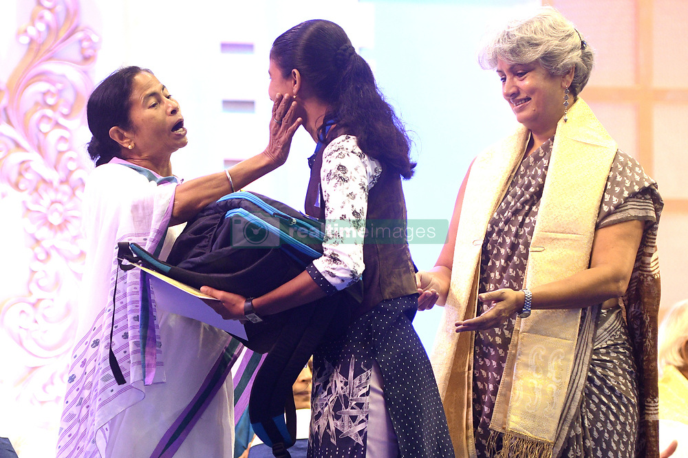 July 28, 2017 - Kolkata, West Bengal, India - Mamata Banerjee Chief Minister of West Bengal felicitate to Students,The West Bengal Government will celebrate the international recognition and appreciation received by Kanyashree Prakalpa at a function in theKolkata, India, on 28 July 2017. It was awarded the First Prize at United Nations Public Service Award Ceremony this year. Representatives from all corners of the state will come together to celebrate the success of Kanyashree girls, who will be felicitated by Chief Minister Mamata Banerjee. Students who have benefited from the Kanyashree Scheme from every district will participate in the celebratory event of this flagship scheme. Kanyashree Scheme is not only Ms Banerjee's most successful project, but it is also the pride of Bengal. It has so far brought 41 lakh girls under its umbrella. The scheme aims at effectively empowering girls through far-sighted, holistic and all-round development, stressing on ending early marriage and opening up options for young women. It even includes development in areas such as sports in Kolkata,India. (Credit Image: © Debajyoti Chakraborty/NurPhoto via ZUMA Press)