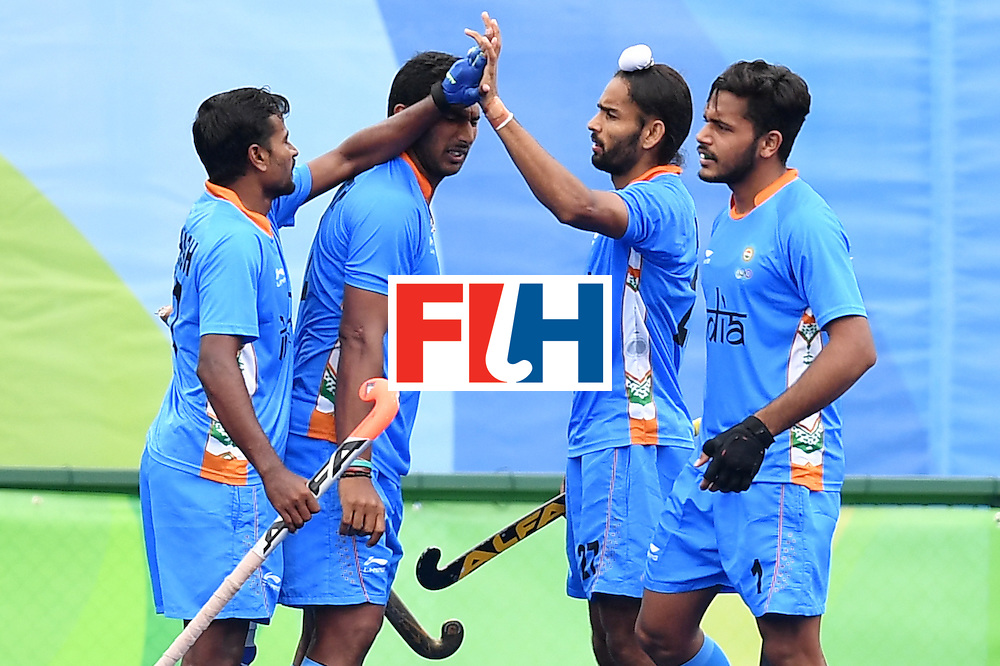 India's Akashdeep Singh celebrates scoring a goal with his teammates during the mens's field hockey India vs Canada match of the Rio 2016 Olympics Games at the Olympic Hockey Centre in Rio de Janeiro on August, 12 2016. / AFP / MANAN VATSYAYANA        (Photo credit should read MANAN VATSYAYANA/AFP/Getty Images)