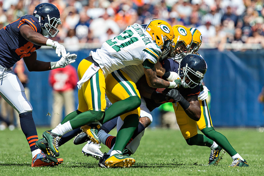 CHICAGO, IL - SEPTEMBER 13:  Martellus Bennett #83 of the Chicago Bears runs the ball and is hit by Clay Matthews #52 and Ha Ha Clinton-Dix #21 of the Green Bay Packers at Soldier Field on September 13, 2015 in Chicago, Illinois.  The Packers defeated the Bears 31-23.  (Photo by Wesley Hitt/Getty Images) *** Local Caption *** Martellus Bennett; Clay Matthews; Ha Ha Clinton-Dix