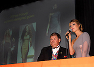 Auctioneer Doug Sorrell watches the crowd, as Althea Harper of Oakwood, who appeared on TV's Project Runway, talks about the dress she'll be designing for the high bidder in her live auction item during the 53rd Annual Art Ball at the Dayton Art Institute, Saturday, June 12, 2010.