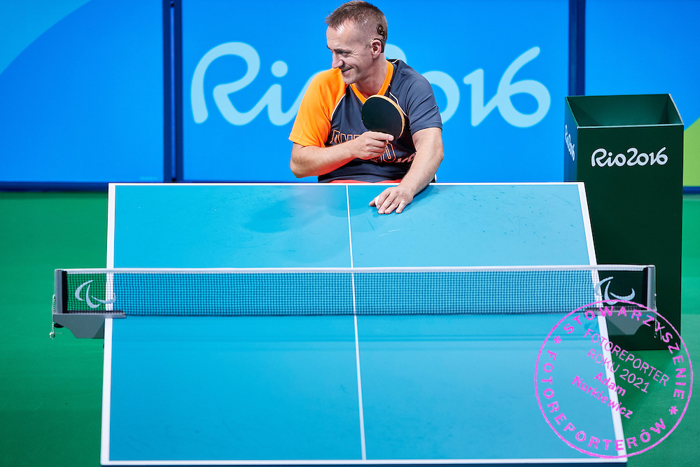 Rio de Janeiro, Brazil - 2016 September 03: Maciej Nalepka from Poland looks at the ball during table tennis training session in Riocentro Pavilion 3 while 2016 Summer Paralympic Games on September 03, 2016 in Rio de Janeiro, Brazil.<br /> Rio 2016 Paralympic Games will be held from September 7 until 18.<br /> <br /> Adam Nurkiewicz declares that he has no rights to the image of people at the photographs of his authorship.<br /> <br /> Picture also available in RAW (NEF) or TIFF format on special request.<br /> <br /> Any editorial, commercial or promotional use requires written permission from the author of image.<br /> <br /> Mandatory credit:<br /> Photo by &copy; Adam Nurkiewicz / Mediasport