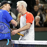 March 1, 2014, Indian Wells, California: <br /> Jim Courier and John McEnroe shake hands after playing each other at the McEnroe Challenge for Charity presented by Esurance in Stadium 2 at the Indian Wells Tennis Garden. <br /> (Photo by Billie Weiss/BNP Paribas Open)