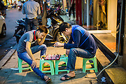 05 APRIL 2012 - HANOI, VIETNAM:   Men play chess on the street in Old Quarter of Hanoi, the capital of Vietnam.   PHOTO BY JACK KURTZ