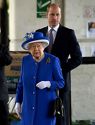Queen Elizabeth II and the Duke of Cambridge arrive to meet members of the community affected by the fire at Grenfell Tower in west London during a visit to the Westway Sports Centre which is providing temporary shelter for those who have been made homeless in the disaster.