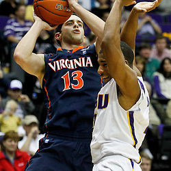 January 2, 2012; Baton Rouge, LA; Virginia Cavaliers guard Sammy Zeglinski (13) shoots over LSU Tigers guard Chris Bass (4) during the first half of a game at the Pete Maravich Assembly Center.  Mandatory Credit: Derick E. Hingle-US PRESSWIRE