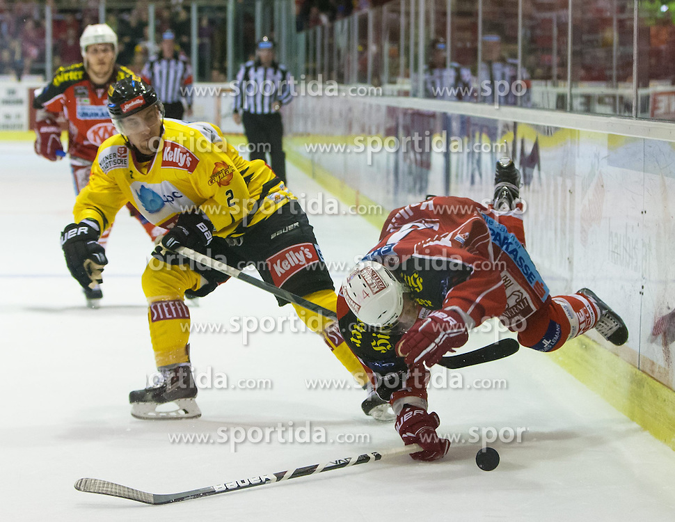 27.10.2013, Stadthalle, Klagenfurt, AUT, EBEL, EC KAC vs Vienna Capitals, 29. Runde, im Bild Peter Sweda (UPC Vienna Capitals, #2), Markus Pirman (KAC, #44) // during the Erste Bank Icehockey League 29th Round match betweeen EC KAC and Vienna Capitals at the City Hall, Klagenfurt, Austria on 2013/10/27. EXPA Pictures © 2013, PhotoCredit: EXPA/ Gert Steinthaler