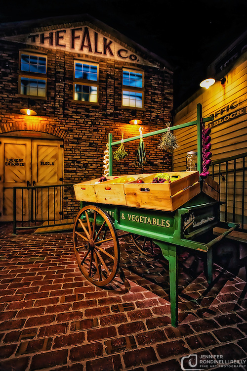 Photo of the Faulk Company building and a Sendik's fruit and vegetable stand in The Streets of Old Milwaukee at the Milwaukee County Museum.