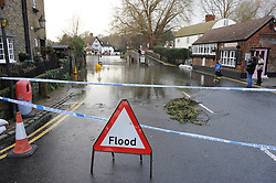 © Licensed to London News Pictures. 24/12/2013<br /> Eynsford Village Flooding in Kent.<br /> The River Darent in Eynsford has flooded and closed the village ford due to heavy rain overnight.<br /> The UK  has woken up to trees and electricity cables down following a night of gale-force winds and torrential rain.<br /> Photo credit :Grant Falvey/LNP