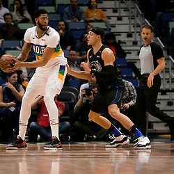 Feb 12, 2019; New Orleans, LA, USA; New Orleans Pelicans forward Anthony Davis (23) is defended by Orlando Magic forward Aaron Gordon (00) during the first quarter at the Smoothie King Center. Mandatory Credit: Derick E. Hingle-USA TODAY Sports