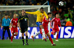 Brazil's Robinho vs Korea's Pak Nam Chol during the 2010 FIFA World Cup South Africa Group G match between Brazil and North Korea at Ellis Park Stadium on June 15, 2010 in Johannesburg, South Africa.  (Photo by Vid Ponikvar / Sportida)