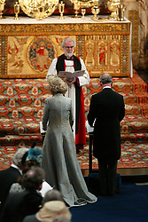 The Prince Of Wales and his new bride the Duchess of Cornwall stand in front of Dr Rowan Williams, the Archbishop of Canterbury during the Service of Prayer and Dedication in St George's Chapel, Windsor Castle.