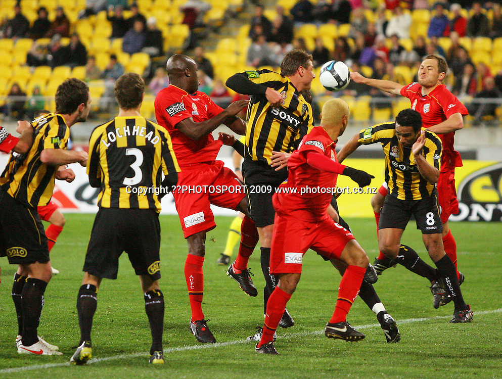 Adelaide's Adam Hughes (right) climbs over Paul Ifill for a header from a Phoenix corner kick.<br /> A-League football - Wellington Phoenix v Adelaide United FC at Westpac Stadium, Wellington. Friday, 4 September 2009. Photo: Dave Lintott/PHOTOSPORT
