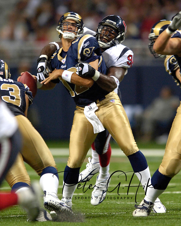 St. Louis quarterback Gus Frerotte (12) is sacked for a 12-yard loss by Houston's Antwan Peek (98) in the second quarter at the Edward Jones Dome in St. Louis, Missouri, August 19, 2006.  The Texans beat the Rams 27-20.