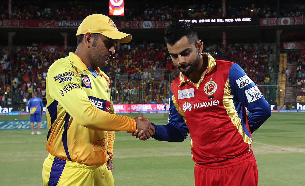 Chennai Super Kings Captain MS Dhoni and Royal Challengers Bangalore captain Virat Kohli shake hands after the toss during match 20 of the Pepsi IPL 2015 (Indian Premier League) between The Royal Challengers Bangalore and The Chennai SUperkings held at the M. Chinnaswamy Stadium in Bengaluru, India on the 22nd April 2015.<br /> <br /> Photo by:  Shaun Roy / SPORTZPICS / IPL